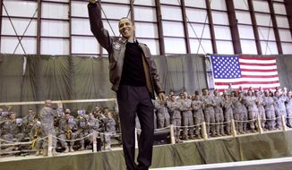 President Barack Obama waves as he is introduced to the troops at a rally during an unannounced visit at Bagram Air Field in Afghanistan on Friday, Dec. 3, 2010. (AP Photo/Pablo Martinez Monsivais)