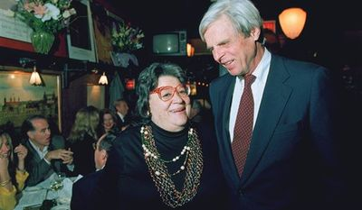 """FILE - In this April 27, 1993 file photo, restaurateur Elaine Kaufman, left, stands with author George Plimpton at her restaurant """"Elaine's"""" in New York. Kaufman, whose East Side establishment became a haven for show business and literary notables, died Friday, Dec. 3, 2010 at the age of 81. (AP Photo/Alex Brandon, File)"""