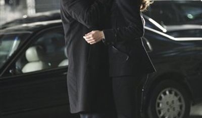 """In this publicity image released by ABC, Nathan Fillion, who portrays Rick Castle, left, and Stana Katic, who portrays NYPD Det. Kate Beckett lock lips in an episode of """"Castle,""""  filmed, Thursday, Dec. 2, 2010 in Los Angeles.  The episode titled """"Knockdown"""" will air in January. (AP Photo/ABC, Adam Taylor)"""