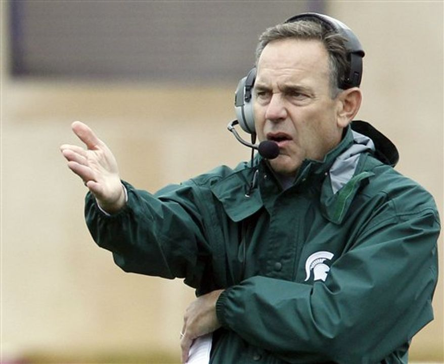 FILE - In this file photo taken Oct. 23, 2010, Michigan State head football coach Mark Dantonio yells to his team during the second quarter of an NCAA college football game against Northwestern in Evanston, Ill. Dantonio is disappointed to see the BCS rankings being used to break a three-way tie atop the Big Ten, but he's only the latest coach to feel aggrieved after ending up in a deadlock. Controversial tiebreakers have been around in college football a lot longer than the BCS. (AP Photo/Nam Y. Huh, File)