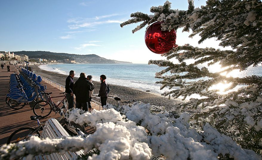 A Christmas tree with synthetic snow is displaying on La Promenade des Anglais, in Nice southern France, Thursday, Dec. 2, 2010. (AP Photo/Lionel Cironneau)