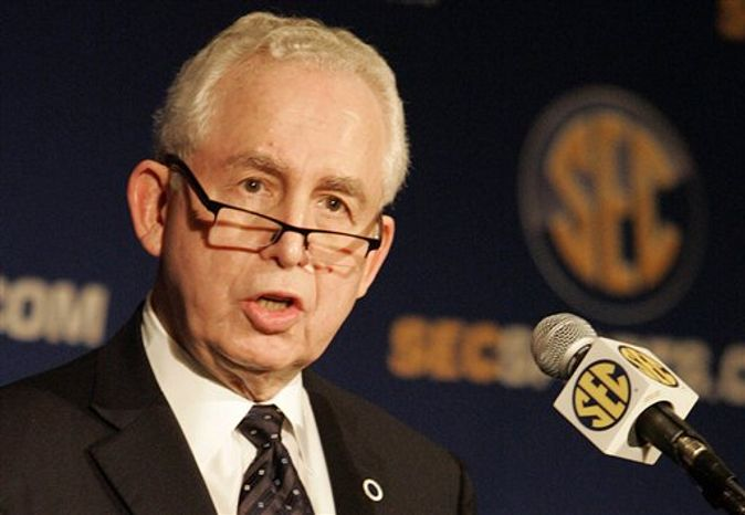 Southeastern Conference commissioner Mike Slive, shown in this July 22, 2009, file photo, announced that an annual New Year's Day bowl game between the SEC and Big 12 will begin in 2014 and last for five years. (AP Photo/ Butch Dill, File)