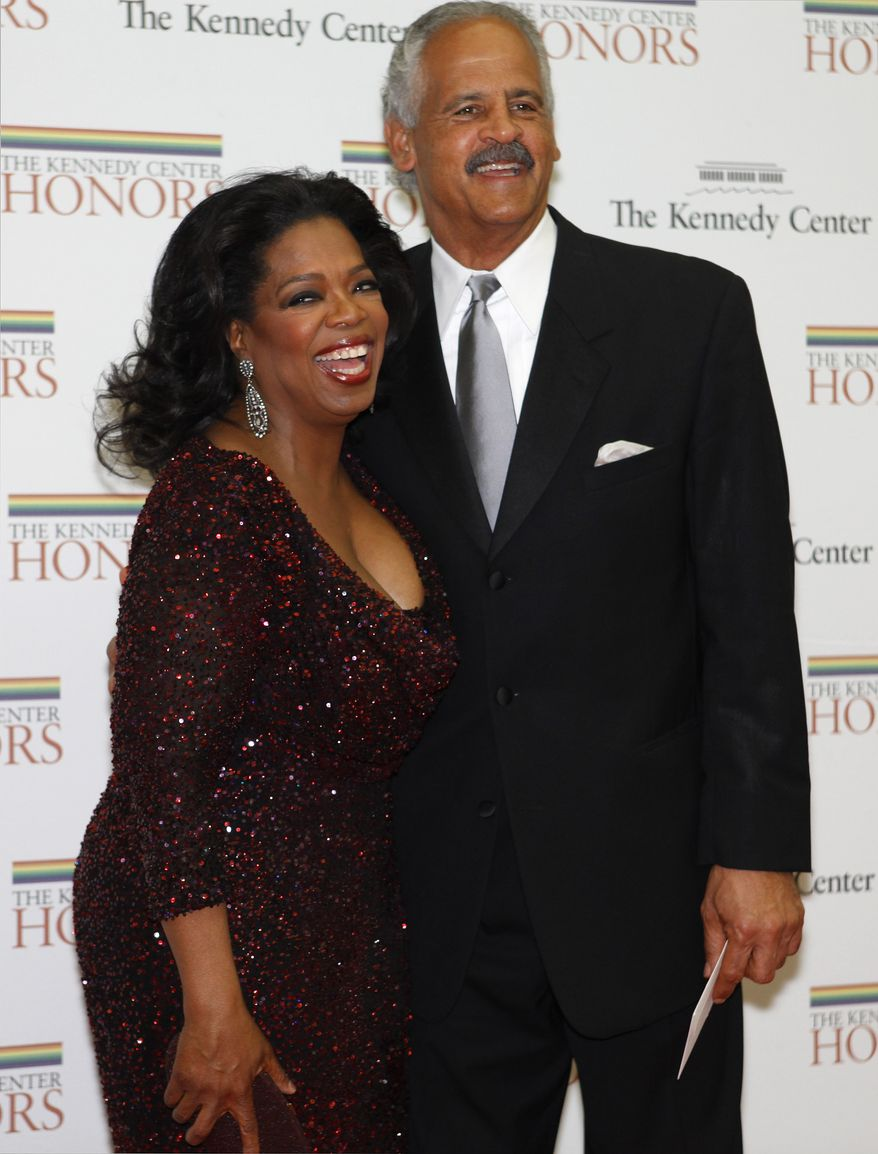 Kennedy Center honoree Oprah Winfrey and her longtime beau, Stedman Graham, pose on the red carpet on arrival at the State Department in Washington on Saturday, Dec. 4, 2010. (AP Photo/Jacquelyn Martin)