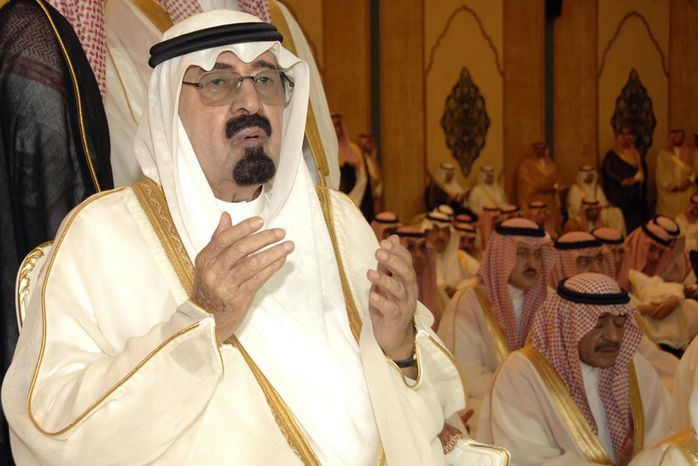 ** FILE ** Saudi Arabia's King Abdullah performs Eid al-Fitr prayers to mark the end of the holy fasting month of Ramadan in Mecca, Saudi Arabia, in September 2010.  (AP Photo/Saudi Press Agency)