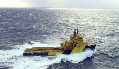 The tug Tor Viking II is observed by an Air Station Kodiak HC-130 Hercules crew moving through 20-foot seas and 46 mph winds 48 miles from the crippled cargo vessel Golden Seas in the Bering Sea on Saturday, Dec. 4, 2010. (AP Photo/U.S. Coast Guard, Petty Officer 1st Class Sara Francis)