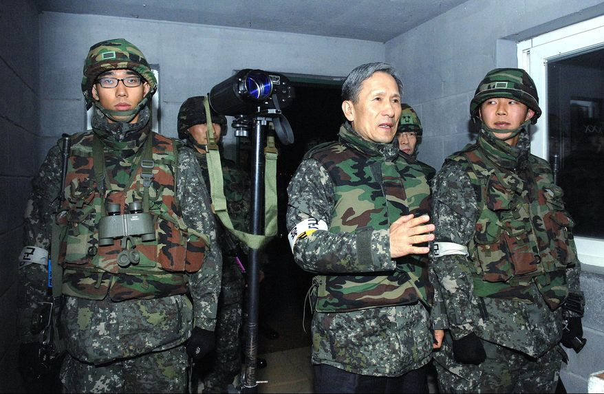South Korean Defense Minister Kim Kwan-jin (second from right) talks with South Korean soldiers during a visit to a military base in the Demilitarized Zone between the two Koreas on Sunday, Dec. 5, 2010, in Paju, South Korea. (AP Photo/Yonhap)