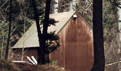 "** FILE ** The cabin of Theodore Kaczynski, dubbed the ""Unabomber,"" is shown in the woods of Lincoln, Mont., in 1996. The 1.4-acre parcel of land once owned by Kaczynski is on the market for $69,500. The cabin now is on exhibit at the Newseum in Washington. (AP Photo/Elaine Thompson, File)"