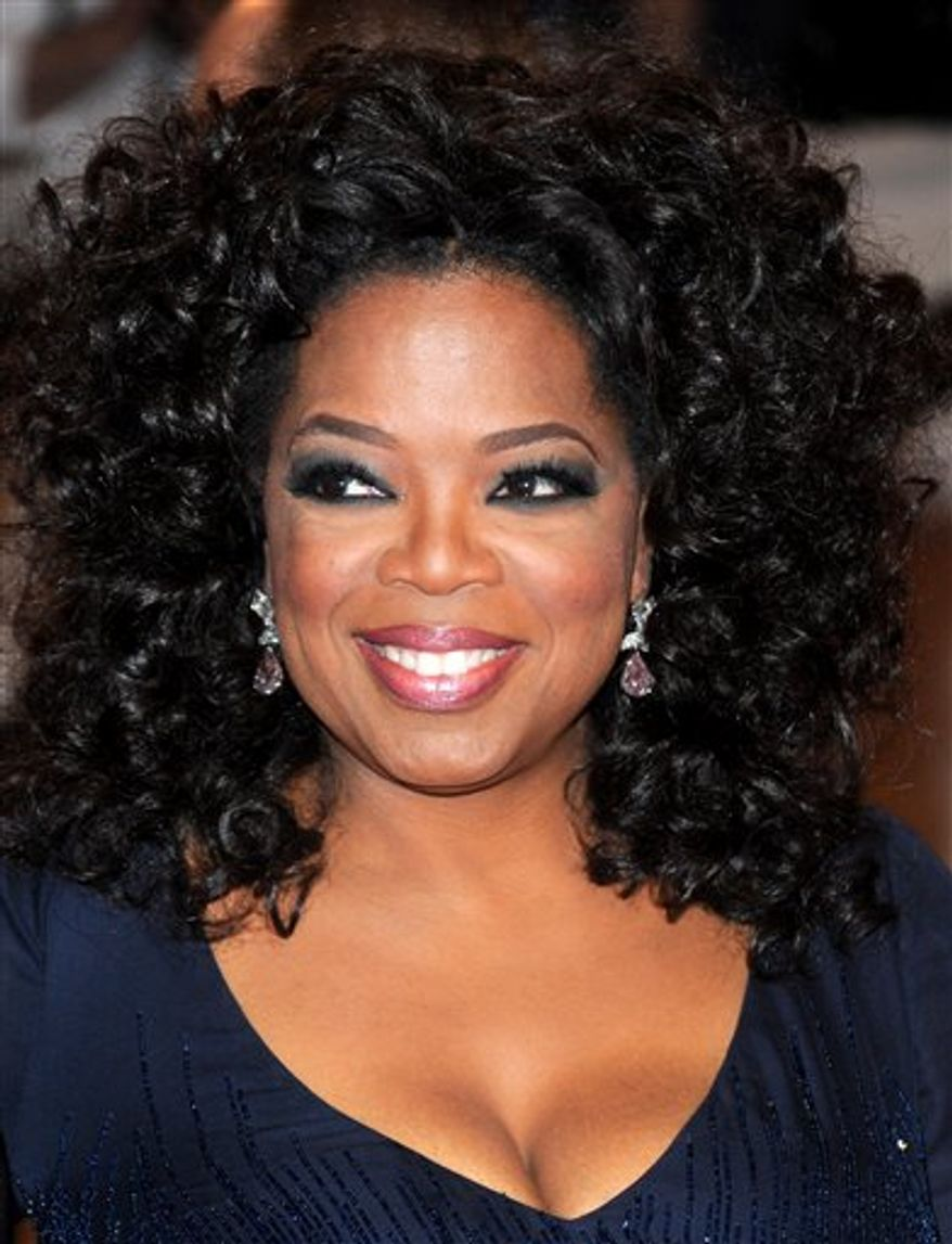 "This photo taken Nov. 19, 2010 in Chicago and provided by Harpo Productions Inc., shows talk-show host Oprah Winfrey announcing on ""The Oprah Winfrey Show"" airing, Monday, Dec. 6, 2010, her book club selections, ""A Tale of Two Cities"" and ""Great Expectations"" by Charles Dickens. (AP Photo/Harpo Productions Inc., George Burns)  NO SALES"