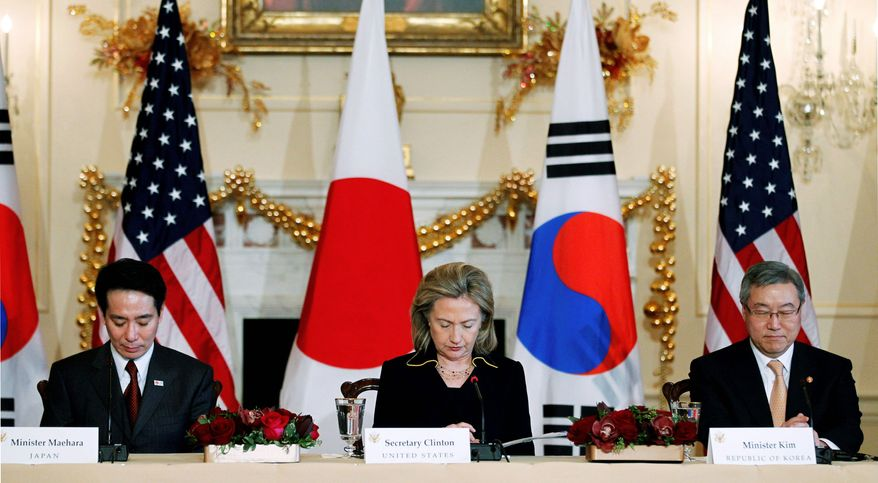 Japanese Foreign Minister Seiji Maehara (left), Secretary of State Hillary Rodham Clinton and South Korean Foreign Minister Kim Sung-hwan observe a moment of silence for the victims of the latest attacks in South Korea by North Korea before the start of their trilateral meeting at the State Department on Monday. (Associated Press)