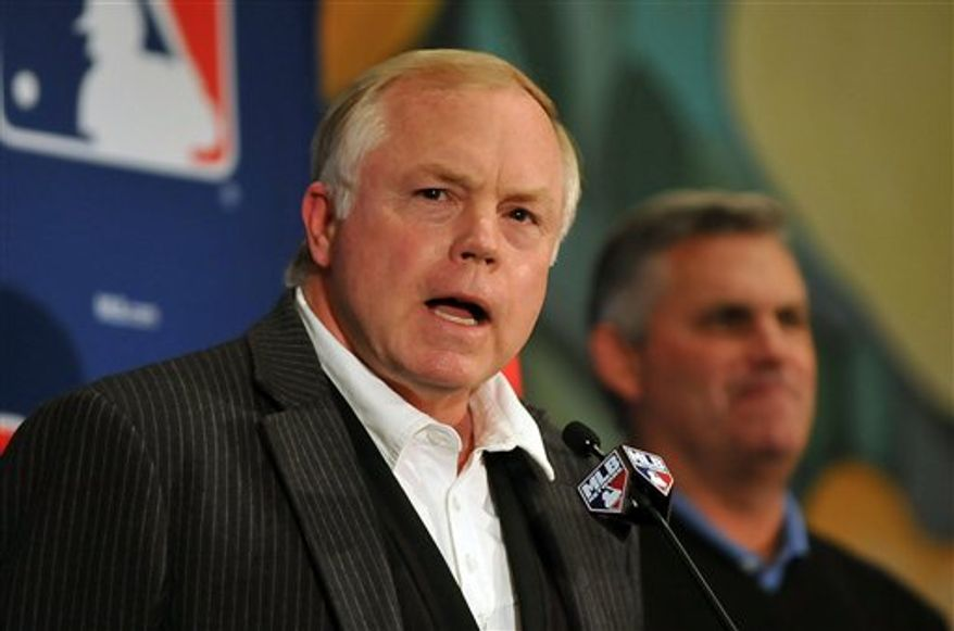 Buck Showalter,left, manager of the Baltimore Orioles, and Kevin Towers discuss their trade for Mark Reynolds at the Major League Baseball Winter Meetings in Lake Buena Vista, Fla., Monday, Dec. 6, 2010. (AP Photo/Roberto Gonzalez)