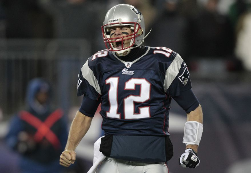 New England Patriots quarterback Tom Brady after a touchdown by running back BenJarvus Green-Ellis against the New York Jets during the first quarter of an NFL football game, Monday, Dec. 6, 2010, in Foxborough, Mass. (AP Photo/Charles Krupa)
