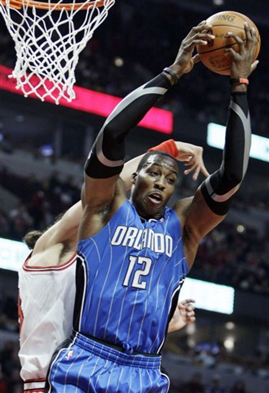 Orlando Magic's Jameer Nelson, left, looks to a pass against Chicago Bulls' Joakim Noah during the third quarter of an NBA basketball game in Chicago, Wednesday, Dec. 1, 2010. The Magic won 107-78. (AP Photo/Nam Y. Huh)