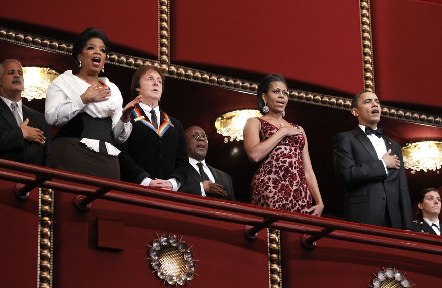 Kennedy Center honorees Oprah Winfrey (second from left) and Paul McCartney (third from left) stand with first lady Michelle Obama (third from right) and President Obama (second from right) during the playing of the national anthem at the 2010 Kennedy Center Honors gala in Washington on Sunday, Dec. 5, 2010. At left is Stedman Graham, Miss Winfrey's longtime beau. (AP Photo/Manuel Balce Ceneta)