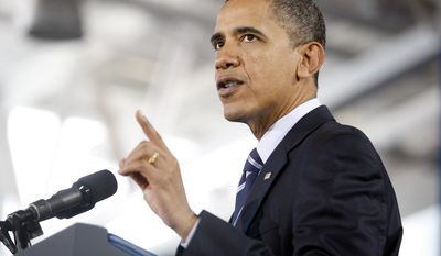 President Barack Obama speaks about the U.S. economy to local business leaders and students and faculty at Forsyth County Technical Community College in Winston-Salem, N.C., on Monday, Dec. 6, 2010. (AP Photo/The News & Observer, Shawn Rocco)