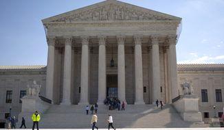 The U.S. Supreme Court building on Capitol Hill in Washington (AP Photo/Evan Vucci, File)