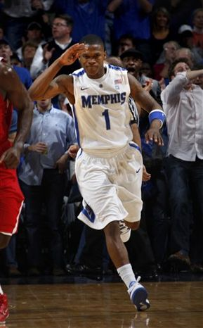 Memphis guard Joe Jackson salutes the crowd after a dunk against Western Kentucky in the first half of an NCAA college basketball game Saturday, Dec. 4, 2010, in Memphis, Tenn.   (AP Photo/Nikki Boertman)