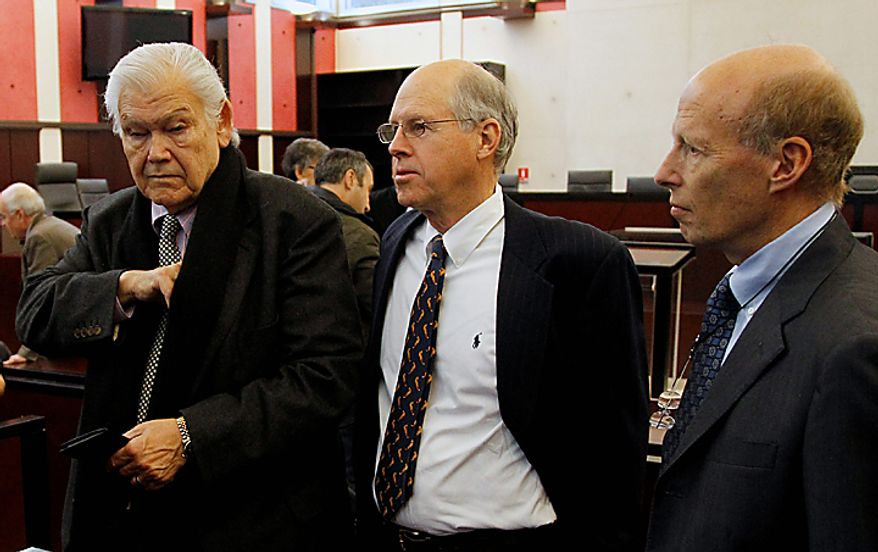 Consultants for Continental Airlines -- from left, lawyer Ed Green; Anthony G. Bouscaren, senior vice president of U.S. Aviation Underwriters; and Capt. Gary A. Wagner, president of Scientific Aircraft Accident Analysis -- wait for the opening of the Air France Concorde crash court case in Pontoise, France, north of Paris, on Monday, Dec. 6, 2010. The court found Continental guilty in the deadly 2000 crash of a Concorde jet that killed 113 people. (AP Photo/Francois Mori)