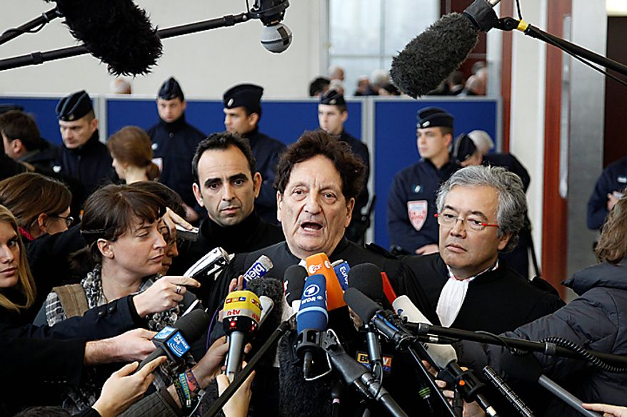 Air France lawyer Fernand Garnault delivers a statement to the media after the conclusion of the Air France Concorde crash court case in Pontoise, France, north of Paris, on Monday, Dec. 6, 2010. The court found Continental Airlines and one of its mechanics guilty over the 2000 crash, which killed 113 people. (AP Photo/Francois Mori)
