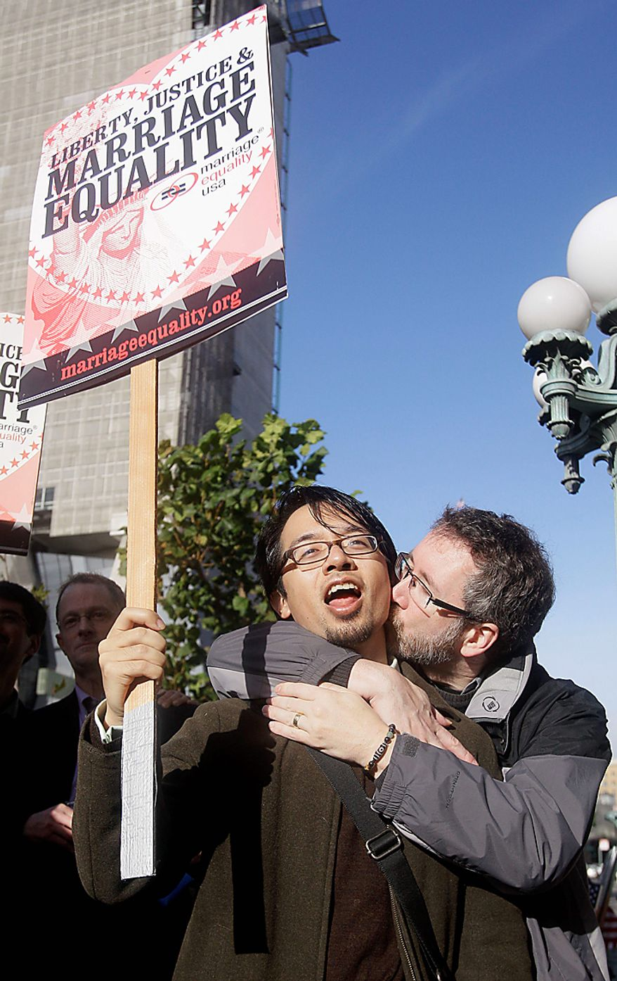 Jeff Tabaco, left, gets a kiss from Thom Watson during a rally outside the courthouse before a hearing in the Ninth Circuit Court of Appeals, Monday, Dec. 6, 2010, in San Francisco. The federal appeals court in San Francisco began to hear arguments Monday about the voter-approved ban known as Proposition 8. A trial court judge overturned the measure as a violation of gay Californians' civil rights in August. (AP Photo/Jeff Chiu)