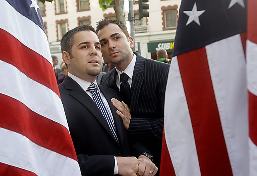 Plaintiffs Jeffrey Zarrillo, left, and Paul Katami are seen outside the courthouse before a hearing in the Ninth Circuit Court of Appeals, Monday, Dec. 6, 2010, in San Francisco. The federal appeals court in San Francisco began to hear arguments Monday about the voter-approved ban known as Proposition 8. A trial court judge overturned the measure as a violation of gay Californians' civil rights in August.  (AP Photo/Jeff Chiu)