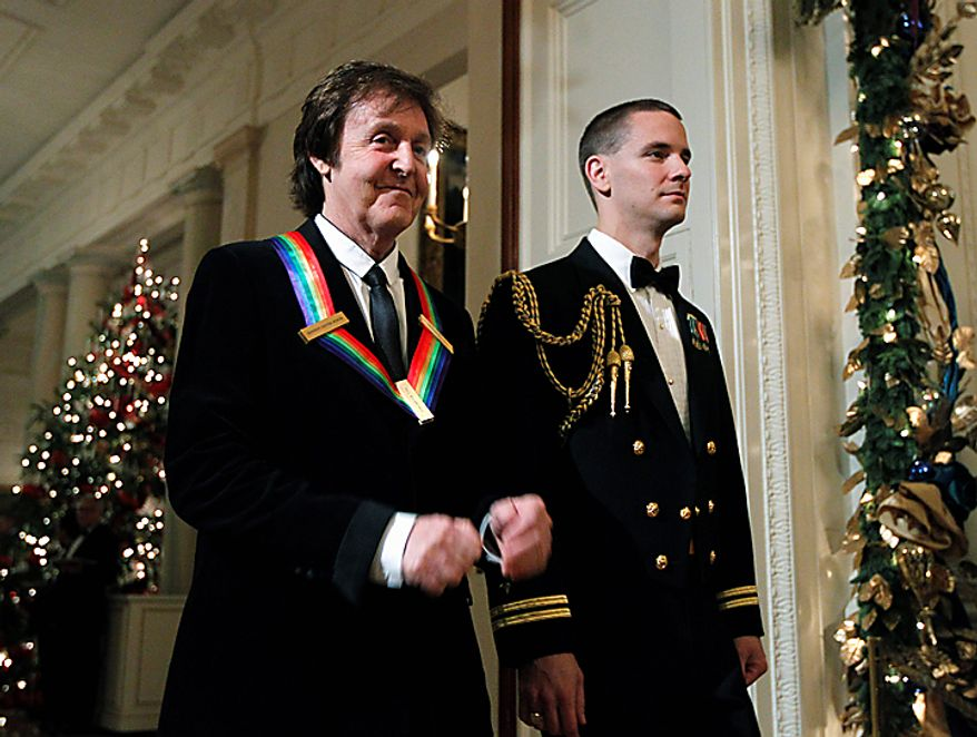 Paul McCartney, a recipient of the  2010 Kennedy Center Honors, is escorted to the East Room for a reception at the White House in Washington, Sunday, Dec. 5, 2010.  (AP Photo/Manuel Balce Ceneta)