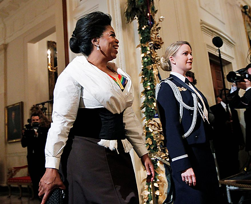Oprah Winfrey, a recipient of the  2010 Kennedy Center Honors, arrives for a reception in the East Room of the White House in Washington, Sunday, Dec. 5, 2010.  (AP Photo/Manuel Balce Ceneta)