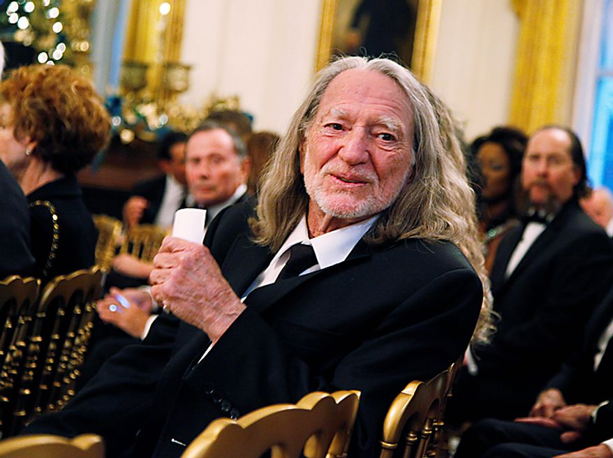 Country singer Willie Nelson attends a reception for the recipients of the 2010 Kennedy Center Honors in the East Room of the White House, Sunday, Dec. 5, 2010.  (AP Photo/Manuel Balce Ceneta)