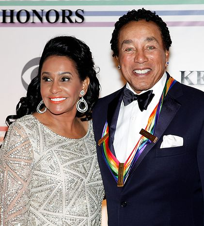 Frances Gladney, left, and husband Smokey Robinson pose on the red carpet at the Kennedy Center Honors in Washington on Sunday, Dec. 5, 2010. (AP Photo/Jacquelyn Martin)
