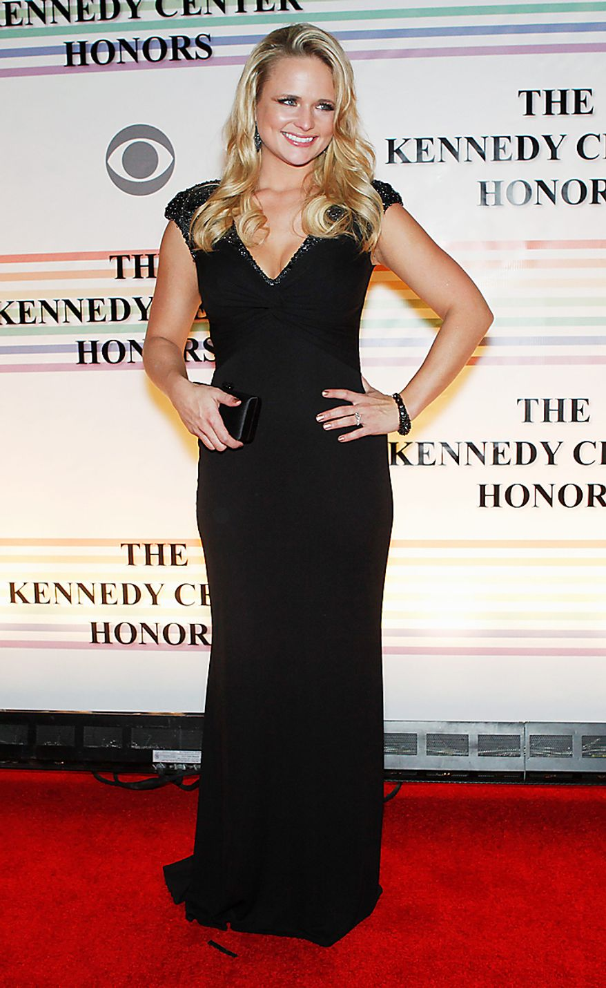 Miranda Lambert walks the red carpet at the Kennedy Center Honors in Washington on Sunday, Dec. 5, 2010. The 2010 honorees were Merle Haggard, Jerry Herman, Bill T. Jones, Paul McCartney and Oprah Winfrey. (AP Photo/Jacquelyn Martin)