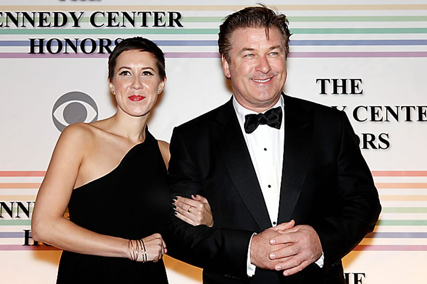 Alec Baldwin and Johanna Cox walk the red carpet at the Kennedy Center Honors in Washington on Sunday, Dec. 5, 2010. The 2010 honorees were Merle Haggard, Jerry Herman, Bill T. Jones, Paul McCartney and Oprah Winfrey. (AP Photo/Jacquelyn Martin)