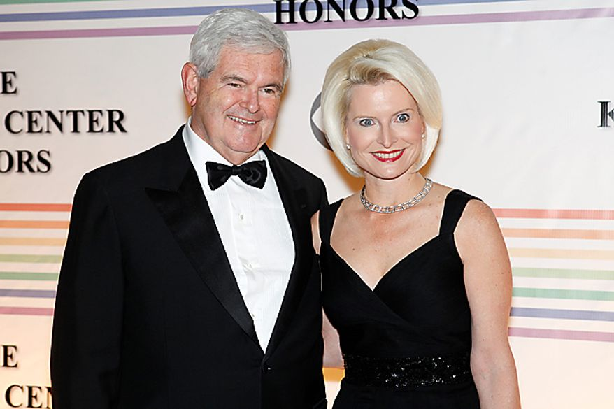 Newt Gingrich and his wife, Callista, walk the red carpet at the Kennedy Center Honors in Washington on Sunday, Dec. 5, 2010. (AP Photo/Jacquelyn Martin)
