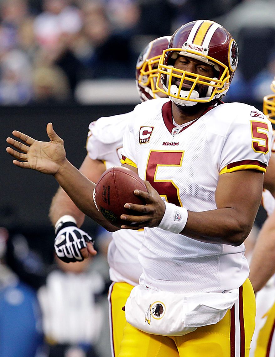 Washington Redskins quarterback Donovan McNabb (5) reacts after a play during the fourth quarter of an NFL football game against the New York Giants at New Meadowlands Stadium, Sunday, Dec. 5, 2010, in East Rutherford, N.J. The Giants won the game 31-7. (AP Photo/Kathy Willens)