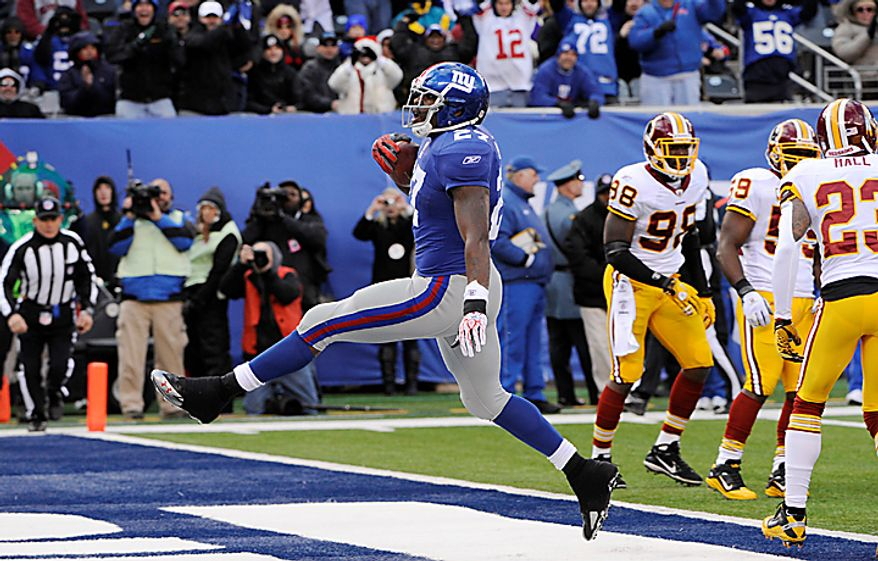 New York Giants running back Brandon Jacobs (27) high-steps into the end zone for a touchdown during the first quarter of an NFL football game against the Washington Redskins at New Meadowlands Stadium, Sunday, Dec. 5, 2010, in East Rutherford, N.J. (AP Photo/Bill Kostroun)