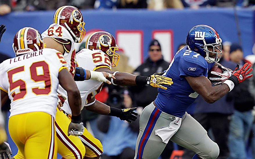 New York Giants running back Brandon Jacobs (27) breaks away from Washington Redskins linebacker Rocky McIntosh (52) during the first quarter of an NFL football game at New Meadowlands Stadium, Sunday, Dec. 5, 2010, in East Rutherford, N.J. (AP Photo/Kathy Willens)