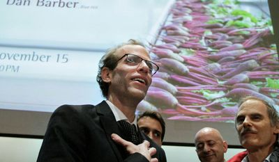 Dan Barber, executive chef and co-owner of New York City's Blue Hill restaurant, lingers after teaching a food-and-science class at Harvard University. International top chefs serve as guest lecturers. (Associated Press)