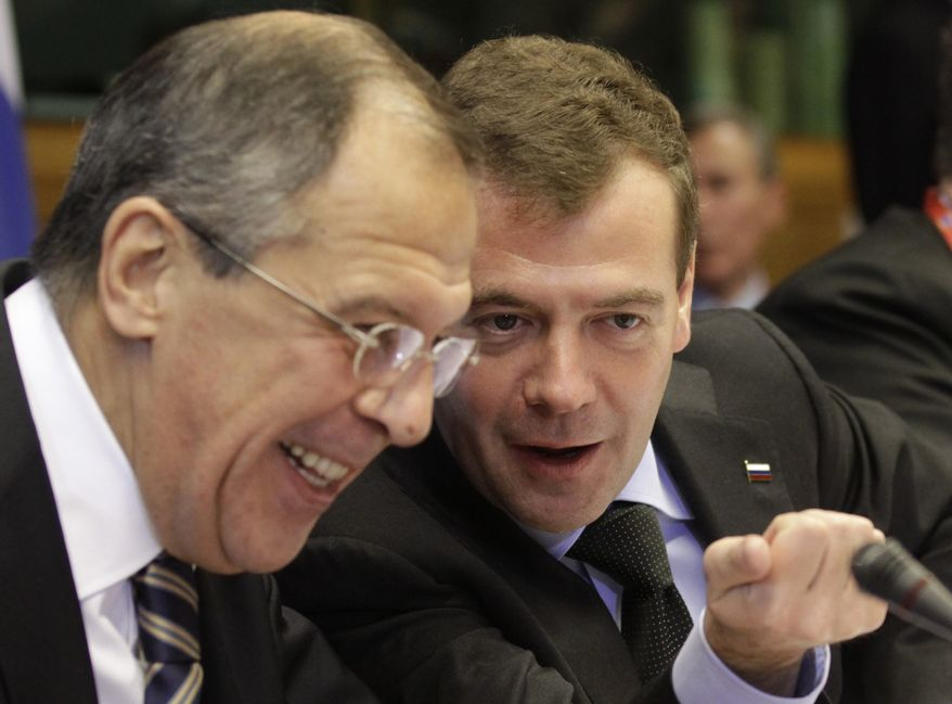 Russian President Dmitry Medvedev (right) talks with Russian Foreign Minister Sergey Lavrov during the European Union-Russia summit in Brussels on Tuesday, Dec. 7, 2010. (AP Photo/Yves Logghe)