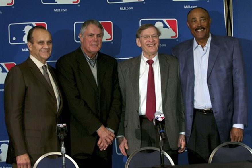 Baseball managers  Joe Torre , left, Lou Piniella, second from left,  and Cito Gaston, right, join baseball commissioner Bud Selig at the Major League Baseball Winter Meetings in Lake Buena Vista, Fla., Tuesday, Dec. 7, 2010.  (AP Photo/Roberto Gonzalez)