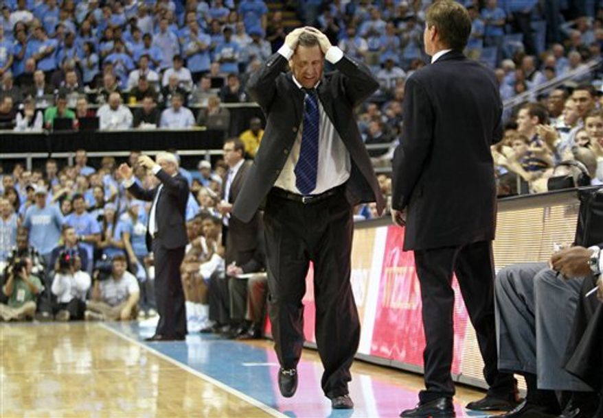 Kentucky coach John Calipari yells during the first half of an NCAA college basketball game against North Carolina in Chapel Hill, N.C., Saturday, Dec. 4, 2010. North Carolina won 75-73. (AP Photo/Gerry Broome)