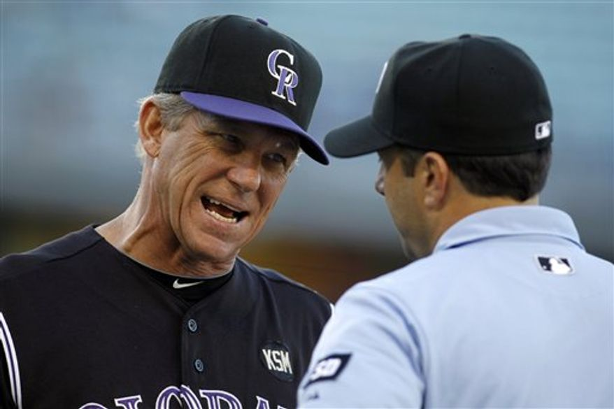 FILE - This Sept. 19, 2010, file photo shows Colorado Rockies manager Jim Tracy, left, arguing with umpire Jim Reynolds during a baseball game against the Los Angeles Dodgers, in Los Angeles. Tracy is resting comfortably at a hospital after collapsing early Tuesday, Dec. 7, 2010,  at the baseball winter meetings in Florida. (AP Photo/Danny Moloshok, File)