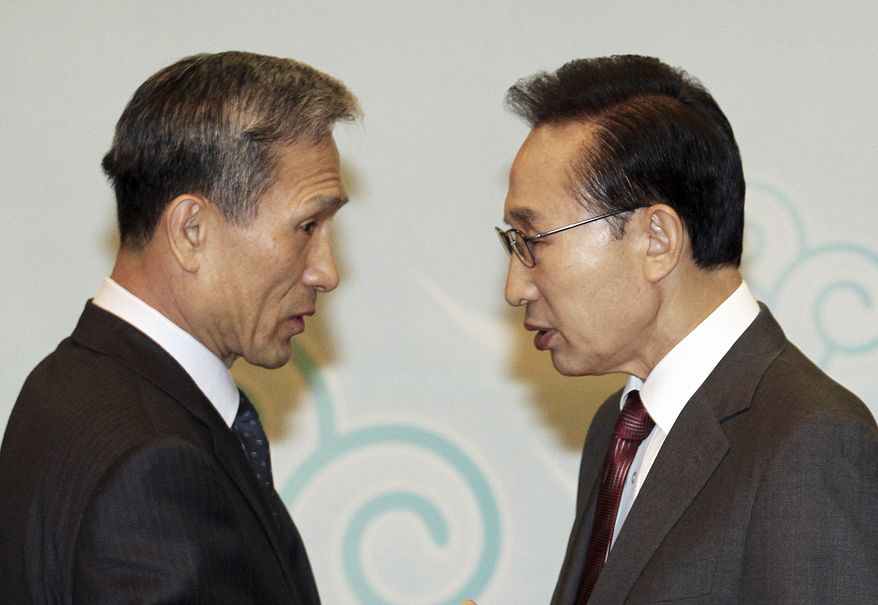 "South Korean President Lee Myung-bak (right) talks with Defense Minister Kim Kwan-jin during a Cabinet meeting at the Blue House, the president's official residence, in Seoul on Tuesday, Dec. 7, 2010. Mr. Lee called for five islands near the disputed sea border with North Korea to be turned into ""military fortresses."" (AP Photo/Yonhap, Jo Bo-hee)"