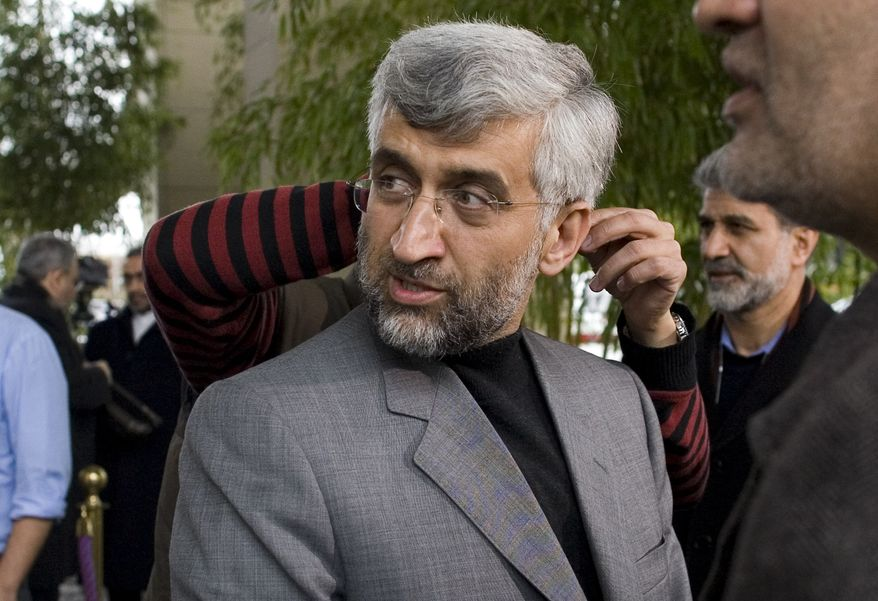 Iran's chief negotiator Saeed Jalili gets earphones fitted as he prepares for an interview with Iranian Television in Geneva, Switzerland, Tuesday, Dec. 7, 2010. Talks between Iran and six world powers are going into a second day with no sign of progress on U.N. Security Council demands that Tehran curbs its nuclear activities. (AP Photo/ Anja Niedringhaus)