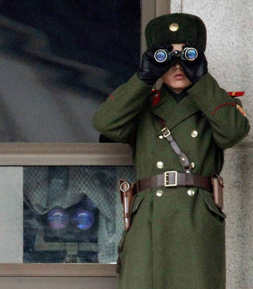 A North Korean soldier looks south from the border village of Panmunjom on Wednesday as the U.S. and South Korea discuss security. (Associated Press)