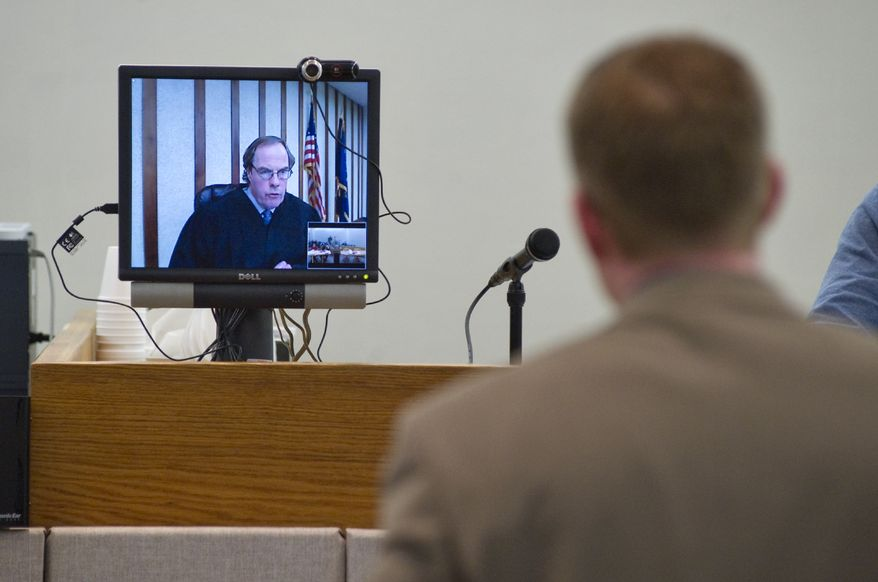 In this Dec. 1, 2010, file photo, Scott Kendall, an attorney for Lisa Murkowski's U.S. Senate campaign, speaks to Ketchikan Superior Court Judge William Carey via teleconference in Juneau, Alaska. (AP Photo/The Juneau Empire, Michael Penn, File)