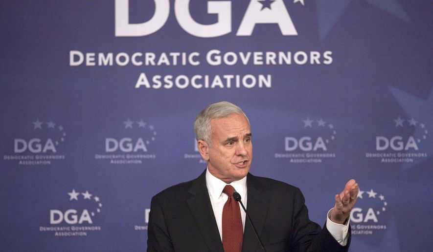 ** FILE ** Minnesota gubernatorial candidate Mark Dayton speaks at the Democratic Governors Association luncheon in Washington on Wednesday, Dec. 1, 2010. (AP Photo/Evan Vucci)