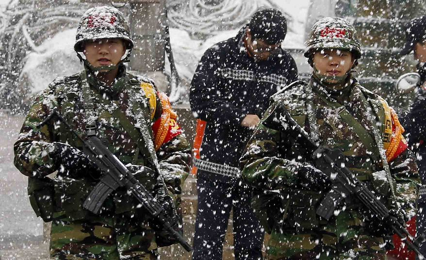 "South Korean Marines patrol in the snow on Yeonpyeong Island, South Korea, Wednesday, Dec. 8, 2010. The top U.S. military officer on Wednesday warned North Korea that the U.S. commitment to helping South Korea defend itself is ""unquestioned,"" even as he pressed China to use its influence to rein in its ally Pyongyang. (AP Photo/Yonhap, Kim hyun-tae)"