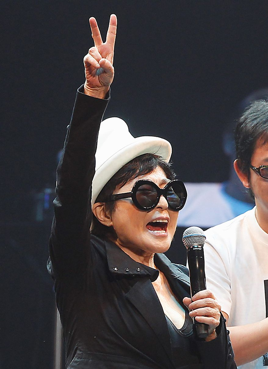 Yoko Ono performs during the Dream Power John Lennon Super Live concert at the Nippon Budokan in Tokyo,  Wednesday, Dec. 8, 2010. Wednesday marks the 30th anniversary of the death of her husband John Lennon, (AP Photo/Shizuo Kambayashi)