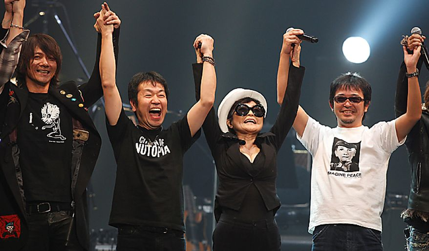 Yoko Ono, second from right, reacts with Japanese singers during the Dream Power John Lennon Super Live concert at the Nippon Budokan in Tokyo,  Wednesday, Dec. 8, 2010. Wednesday marks the 30th anniversary of the death of her husband John Lennon. (AP Photo/Shizuo Kambayashi)