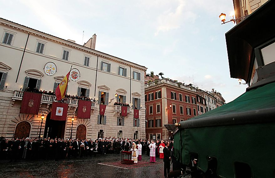 Pope Benedict XVI reads his message as he stands in front of the statue of the Virgin Mary on the occasion of the Immaculate Conception feast, in Rome, Wednesday, Dec. 8, 2010. Pope Benedict XVI inaugurated the Christmas season in Rome with his traditional visit to the posh Spanish Steps neighborhood to pray before the statue of Mary. Throngs of shoppers, tourists and Romans alike jammed the rain-slicked cobblestones around the piazza to catch a glimpse of Benedict. (AP Photo/Gregorio Borgia)