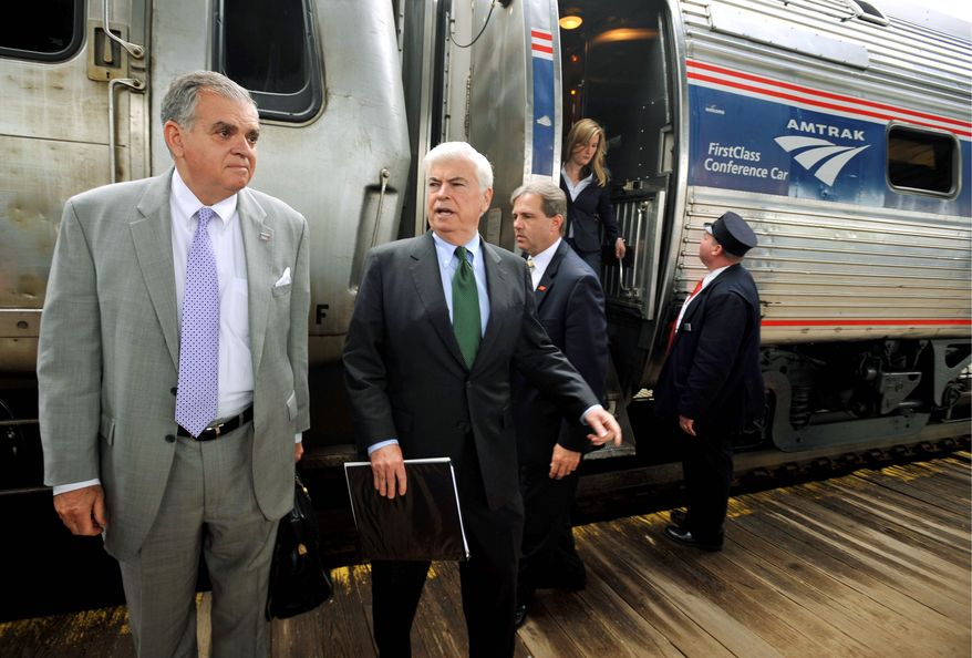 Transportation Secretary Ray LaHood (left), seen here in April with Sen. Christopher J. Dodd, Connecticut Democrat, get off an Amtrak train in Hartford, Conn. Mr. LaHood said Thursday he was reallocating $1.2 billion in federal rail-project funds turned down by two states. (Associated Press)