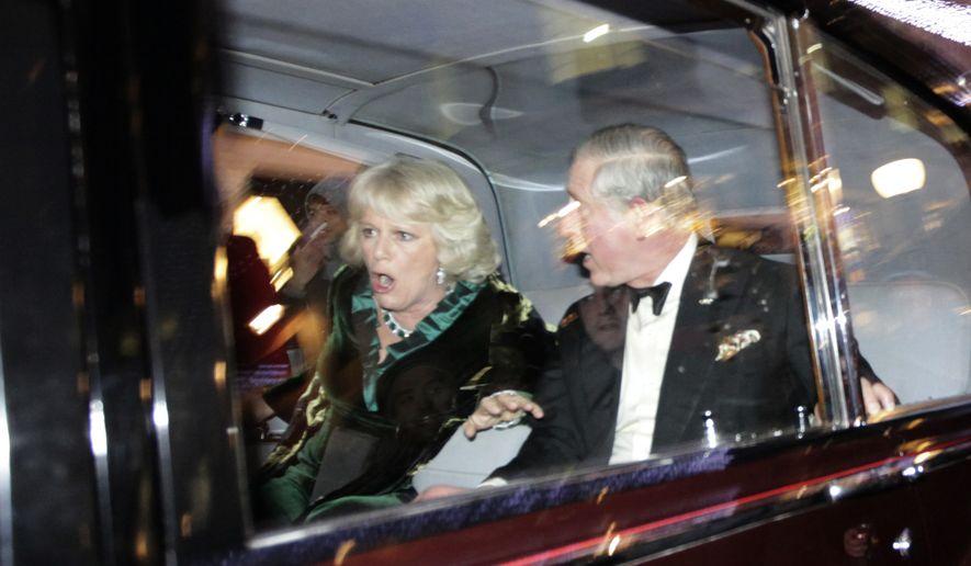 Britain's Prince Charles and Camilla, Duchess of Cornwall, react as their car is attacked, in London, Thursday, Dec. 9, 2010. (AP Photo/Matt Dunham)